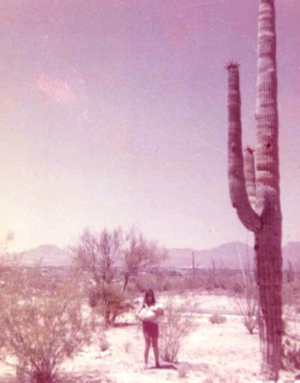 This is me in the front yard of our home in the Tucson desert (holding my dog), circa 1968.